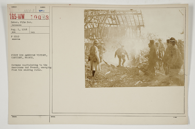 Chemical Warfare Service - Liquid Fire - First big American victory, Cantigny, France.  Germans capitulating to the Americans and French, emerging from the smoking ruins