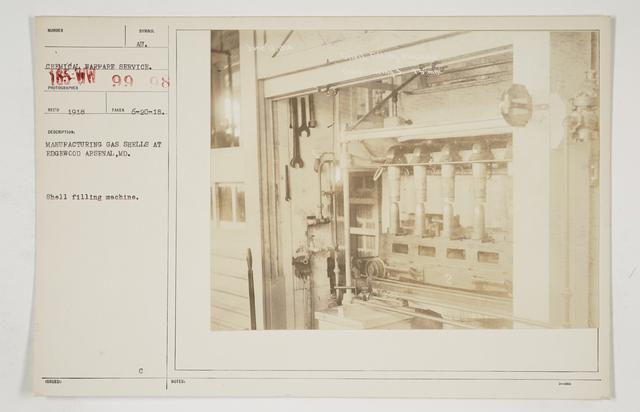 Chemical Warfare Service - Plants - Edgewood Arsenal - Manufacturing gas shells at Edgewood Arsenal, Maryland.   Shell filling machine