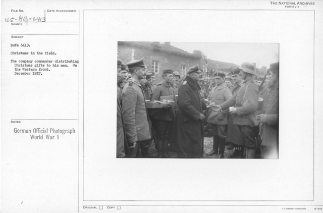 Christmas in the field. The company commander distributing christmas gifts to his men. On the Western front. December 1917
