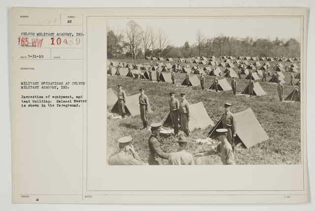 Colleges and Universities - Culver Military Academy - Military operations at Culver Military Academy, Culver, Indiana.  Inspection of equipment, and tent building.  Col1l Hester is shown in the foreground