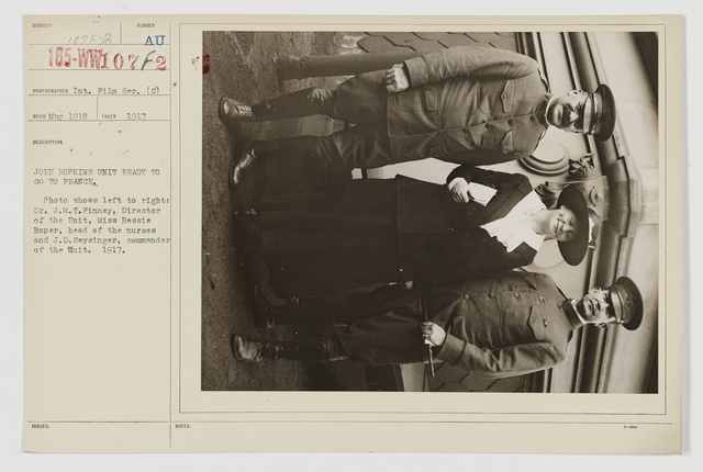 Colleges and Universities - Johns Hopkins - John Hopkins Unit ready to go to France.  Photo shows left to right:  Dr. J.M.T. Finney, Director of the Unit, Miss Bessie Boper, Head of the Nurses and J.D. Seysinger, Commander of the Unit.  1917