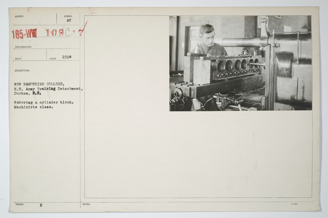 Colleges and Universities - New Hampshire College - New Hampshire College, U.S. Army Training Detachment, Durham, New Hampshire.    Reboring a cylinder block.  Machinists class