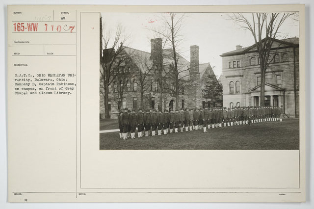 Colleges and Universities - Ohio Wesleyan University - S.A.T.C., Ohio Wesleyan University, Delaware, Ohio.  Company B, Captain Robinson, on campus, on front of Gray Chapel and Slocum Library