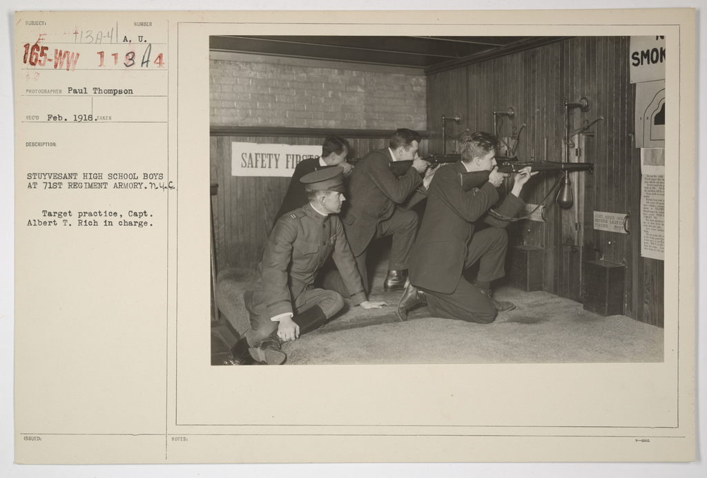 Colleges and Universities - Stuyvesant High School - Students of Stuyvesant high school boys at the 71st Regiment Army, New York City.  Target practice, Captain Albert T. Rich in charge