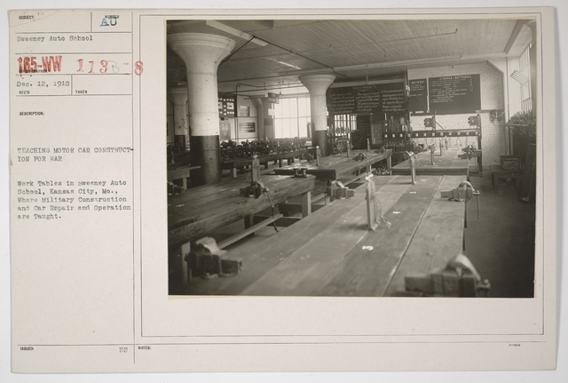 Colleges and Universities - Sweeny Auto School - Teaching Motor Car Construction for War.  Work tables where military construction and car repair and operation are taught in Sweeny Auto School, Kansas City, Missouri