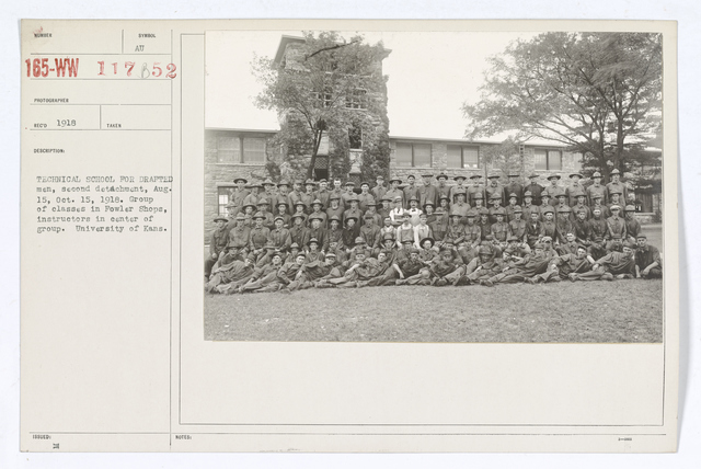 Colleges and Universities - University of Kansas - Technical school for drafted men, second detachment, August 15, October 15, 1918. Group of classes in Fowler Shops, instructors in center of group. University of Kansas