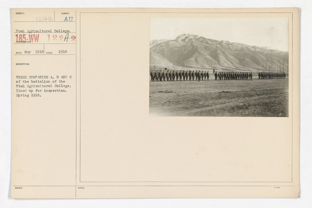 Colleges and Universities - Utah Agricultural College - Three Companies A, B and C of the battalion of the Utah Agricultural College, lined up for inspection. Spring 1918