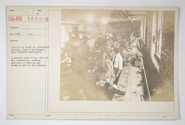 Colleges and Universities - West Virginia University - Section of class in automobile repairs, second detachment. West Virginia University. A general view of 1 part of the laboratory, showing soldiers at work on the machines and at the benches