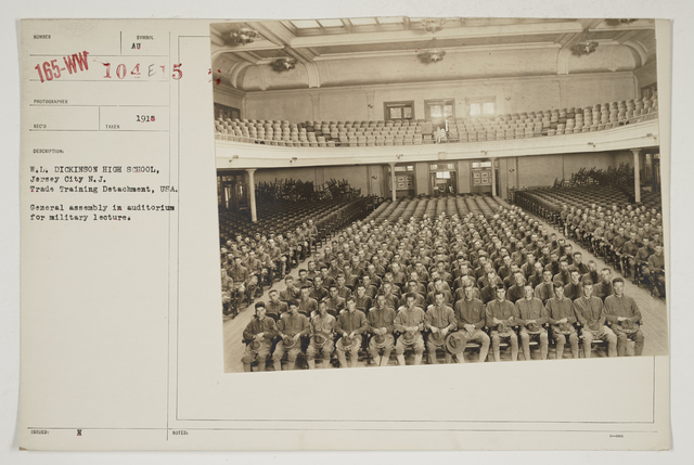 Colleges and Universities - William L. Dickinson High School - Jersey City, New Jersey - W. L. Dickinson High School, Jersey City, New Jersey.  Trade Training Detachment, USA.   General assembly in auditorium for military lecture