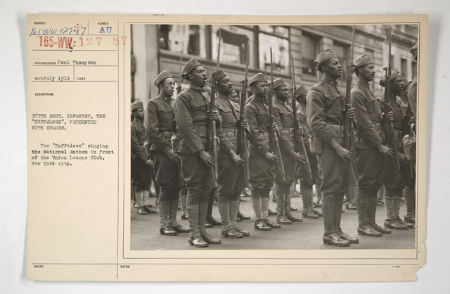 """Colored Troops - 367th Regiment, Infantry, the """"Buffaloes,"""" presented with colors.  The """"Buffaloes"""" singing the National Anthem in front of the Union League Club, New York City"""