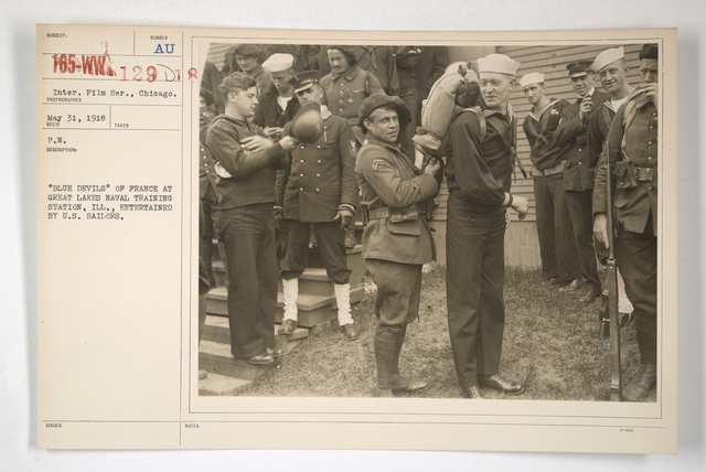 """Commission - From Foreign Nations - France - Blue Devils - """"Blue Devils"""" of France at Great Lakes Naval Training Station, Illinois. Entertained by U.S. Sailors"""