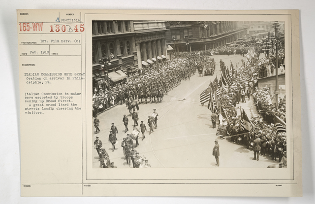 Commissions - Italy - Italian Commission gets great ovation on arrival in Philadelphia, Pennsylvania. Italian Commission in motor cars escorted by troops coming up Broad Street.  A great crowd lined the streets loudly cheering the visitors