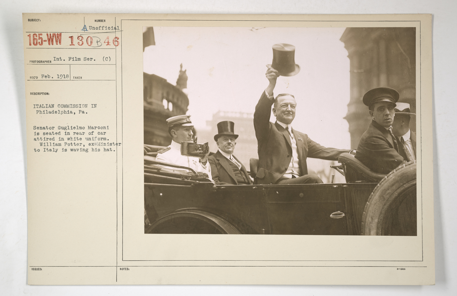 Commissions - Italy - Italian Commission in Philadelphia, Pennsylvania.  Senator Guglielmo Marconi is seated in rear of car attired in white uniform.  William Potter, ex-minister to Italy is waving his hat