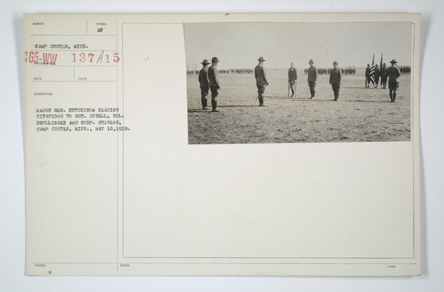 Decorations - Presentations - American - Major General Hutcheson reading citations to Sergeant Covell, Col1l Drollinger and Corporal Stevens, Camp Custer, Michigan, May 10, 1919