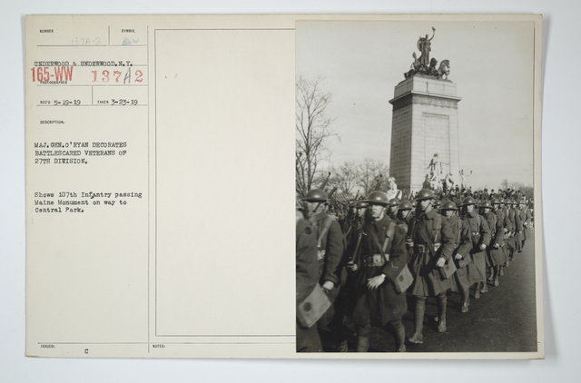 Decorations - Presentations - American - Major General O'Ryan decorates battle-scarred veterans of 27th Division. Shows 107th Infantry passing Maine Monument on way to Central Park