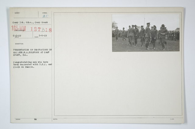 Decorations - Presentations - DSM and CM of Honor - Presentation of decorations by Major General W.A. Holbrook at Camp Grant, Illinois. Congratulating men who have been decorated with D.S.C. and Croix de Guerre