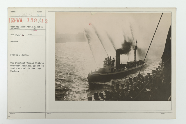Demobilization - Arrivals Home - Firing a salvo. The fireboat Thomas Willett welcomes American troops of their arrival in New York Harbor