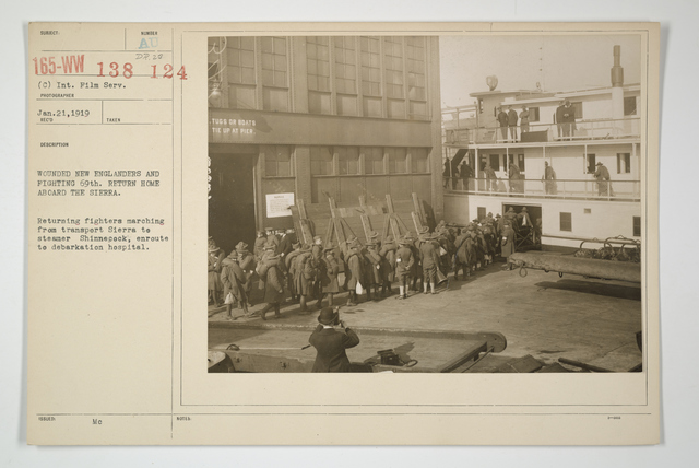 Demobilization - Miscellaneous - Wounded New Englanders and fighting 69th return home aboard the Sierra. Returning fighters marching from transport Sierra to steamer Shinnecock, enroute to debarkation hospital