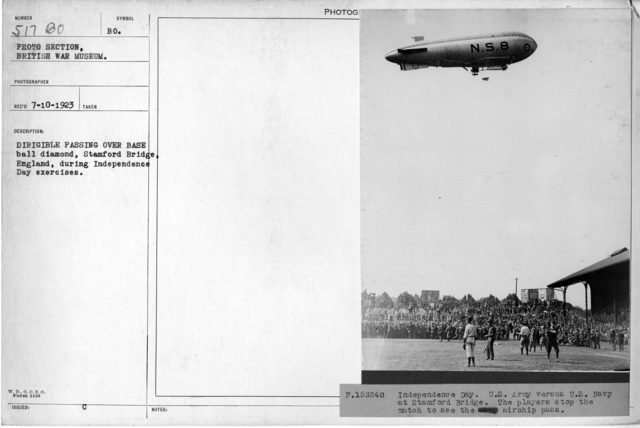 Dirigible passing over baseball diamond, Stamford Bridge, England, during Independence Day exercises