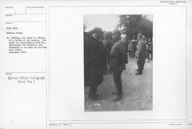 Dr. Fehling, the mayor of Lubeck, at a review of his people. The mayor in conversation with his Excellency von Eichhorn, the commander of an army on the Eastern front.September 1917