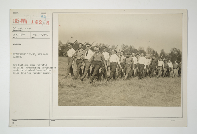 Drills - Civilian Bodies - Civilians - Governors Island, New York Harbor. New National Army recruits drilling. Preliminary instruction could be obtained here before going into the regular camps