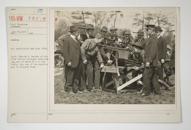 Drills - Police - War Activities New York City. Captain Edward J. Bourke of the 33rd Police Precinct instructing men of Class I A in the Draft, the use of the machine guns in Central Park