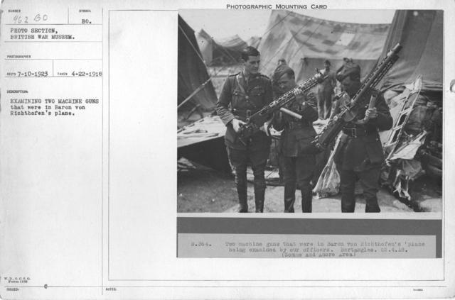 Examining two machine guns that were in Baron von Richthofen's plane. 4-22-1918