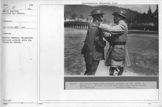 French General decorating British soldier with the Croix de Guerre