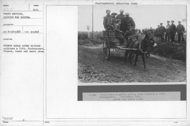 French girls give British soldiers a lift. Toutencourt, France, Somme and Ancre area. September 1916