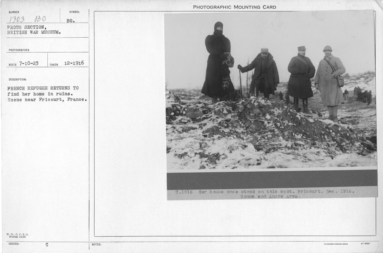 French refugee returns to find her home in ruins. Scene near Fricourt, France. 12-1916