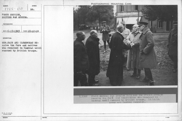 Gen. Haig and Clemenceau receive the Cure and natives who remained in Cambrai until rescued by British troops