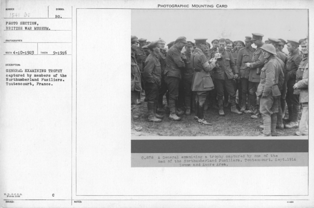 General examining trophy captured by members of the Northumberland Fusiliers. Toutencourt, France. September 1916