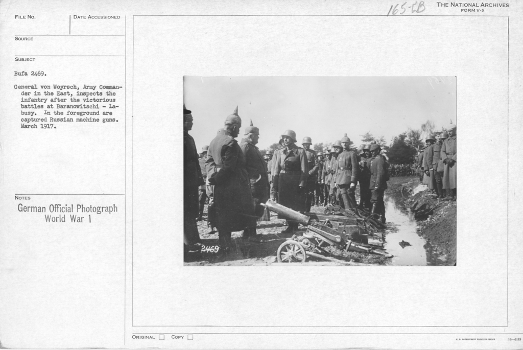 General Von Woyrsch, Army Commander in the East, inspects the infantry after the victorious battles at Baranowitschi- La- Busy. In the foreground are captured russian machine guns. March 1917
