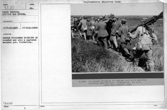 German prisoners bringing in wounded and also a captured machine gun. Croiselles