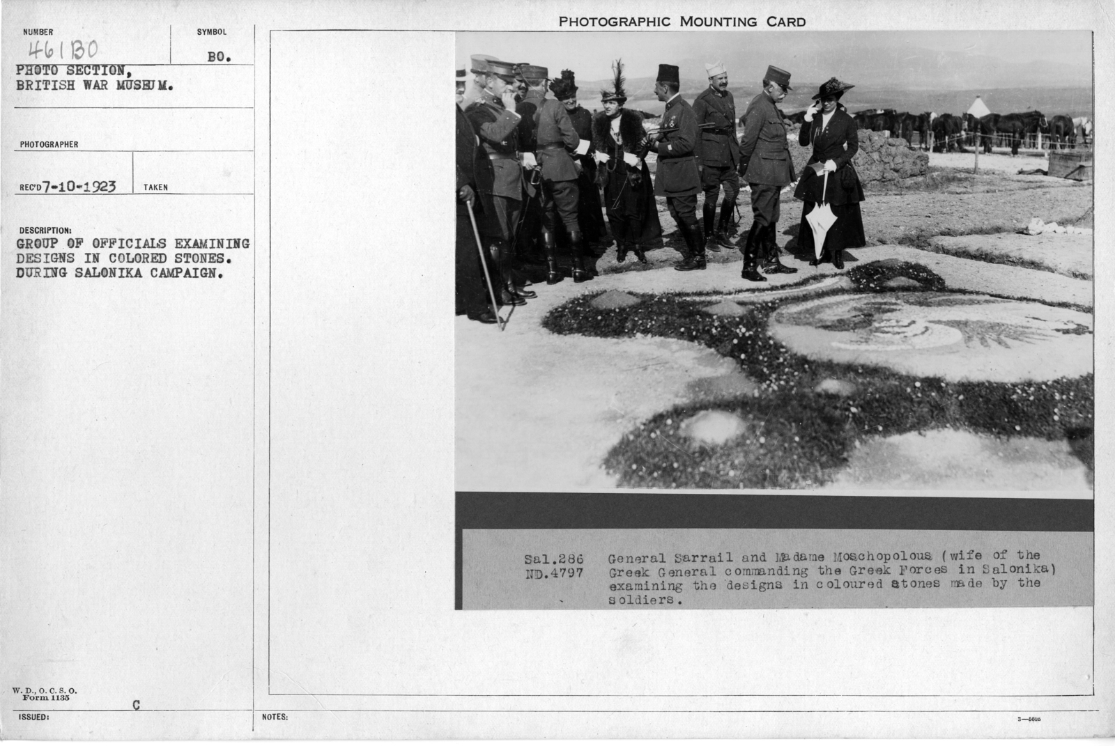 Group of officials examining designs in colored stones. During Salonika Campaign