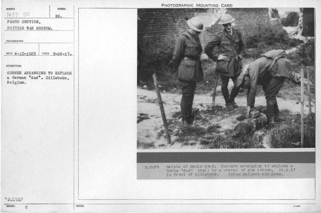 "Gunner arranging to explode a German ""dud"". Zillebeke, Belgium"