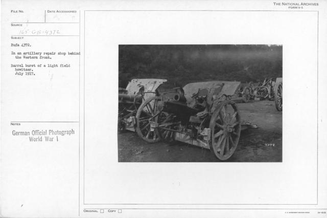 In an artillery repair shop behind the Western front. Barrel Burst of a light field howitzer. July 1917
