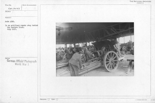 In an artillery repair shop behind the Western front
