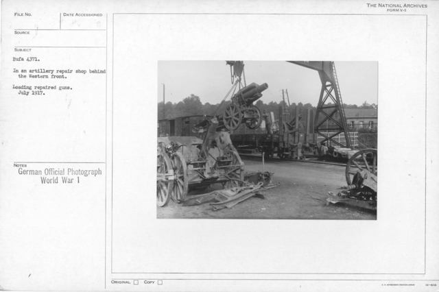 In an Artillery repair shop behind the Western front. Loading repaired guns. July 1917