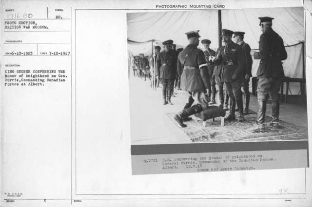 King George conferring the Honor of Knighthood on Lieut. Gen. Currie, Commanding Canadian forces at Albert