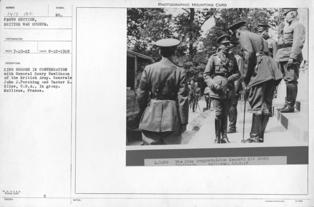 King George in conversation with General Henry Rawlinson of the British Army. Generals John J. Pershing and Tasker H. Bliss, U.S.A., in group. Molliens, France