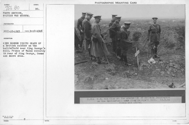 King George visits grave of British soldier on the battlefield near King George's Hill. Prince of Whales directly in rear of King George, Somme and Ancre Area. 8-10-1916