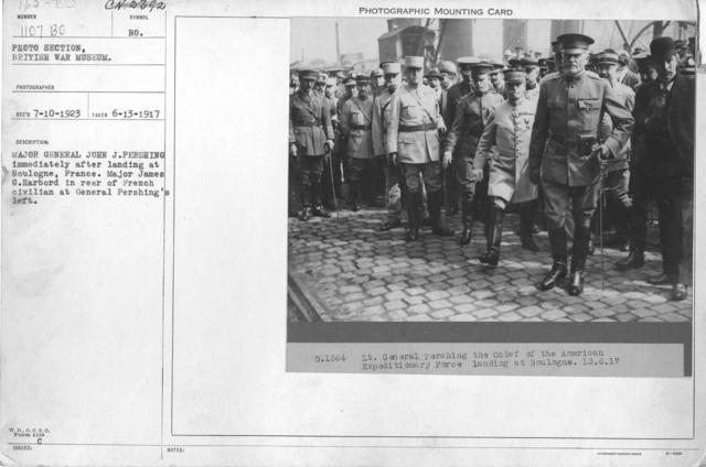 Major General John J. Pershing immediately after landing at Boulogne, France. Major James G. Harbord in rear of French civilian at General Pershing's left