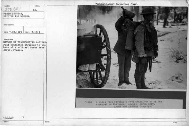 Method of transporting rations. Food container strapped to the back of a soldier. Scene near Arras, France; 3/1917