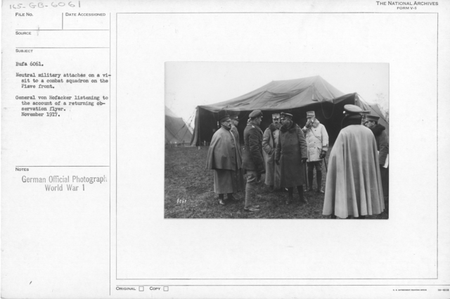 Neutral military attaches in a visit to a combat squadron on the Piave front. General von Hofacker Listening to the account of returning observation flyer. November 1917