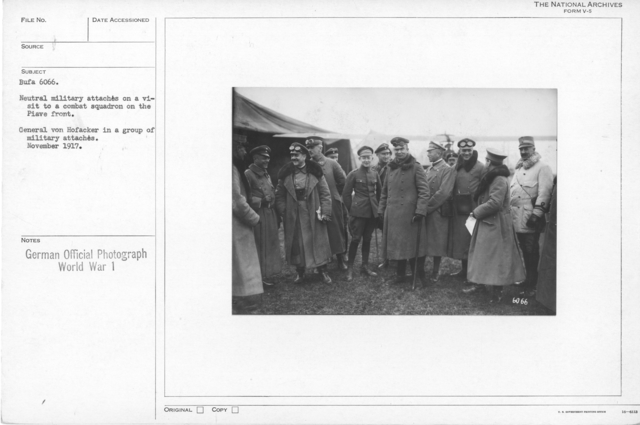 Neutral military attaches on a visit to a combat squardon on the Piave front. General von Hofacker in a group of military attaches.  November 1917