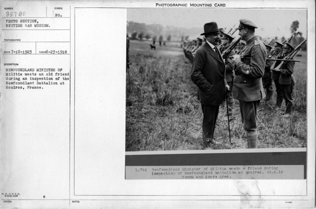 Newfoundland Minister of Militia meets an old friend during an inspection of the Newfoundland Battalion at Ecuires, France; 6/23/1918