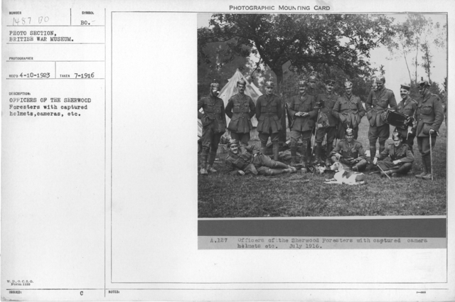 Officers of the Sherwood Foresters with captured helmets, cameras, etc