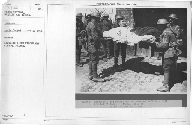 Removing a bed ridden man Robecq, France. 4-12-1918
