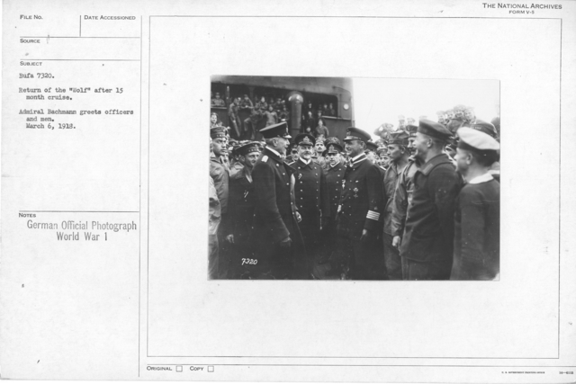"""Return of the """"Wolf"""" after 15 month cruise. Admiral Bachmann greets officers and men. March 6, 1918"""